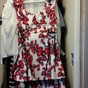 Intense rose print, with black ribbon laceups on the sides.