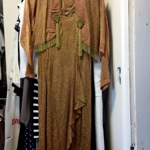Copper and moss patterned dress and jacket with beaded ornaments and fringe