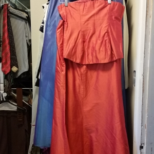 Two two-part evening dresses, periwinkle blue with lavender, and flame orange
