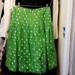 Green skirt with navy-ringed white polka dots